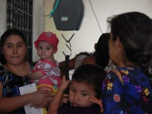 Weighing babies in Magdalena