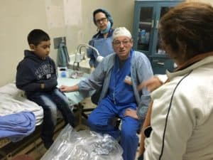 Dr Rolandelli with young patient