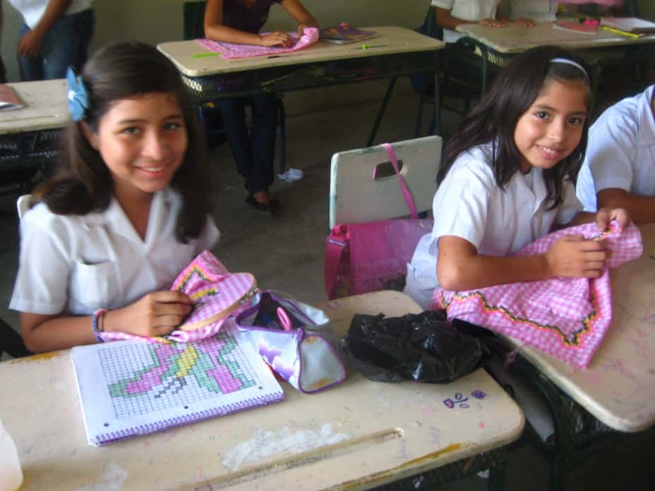 Yo Puedo participants working on pillows to be sold at the local market