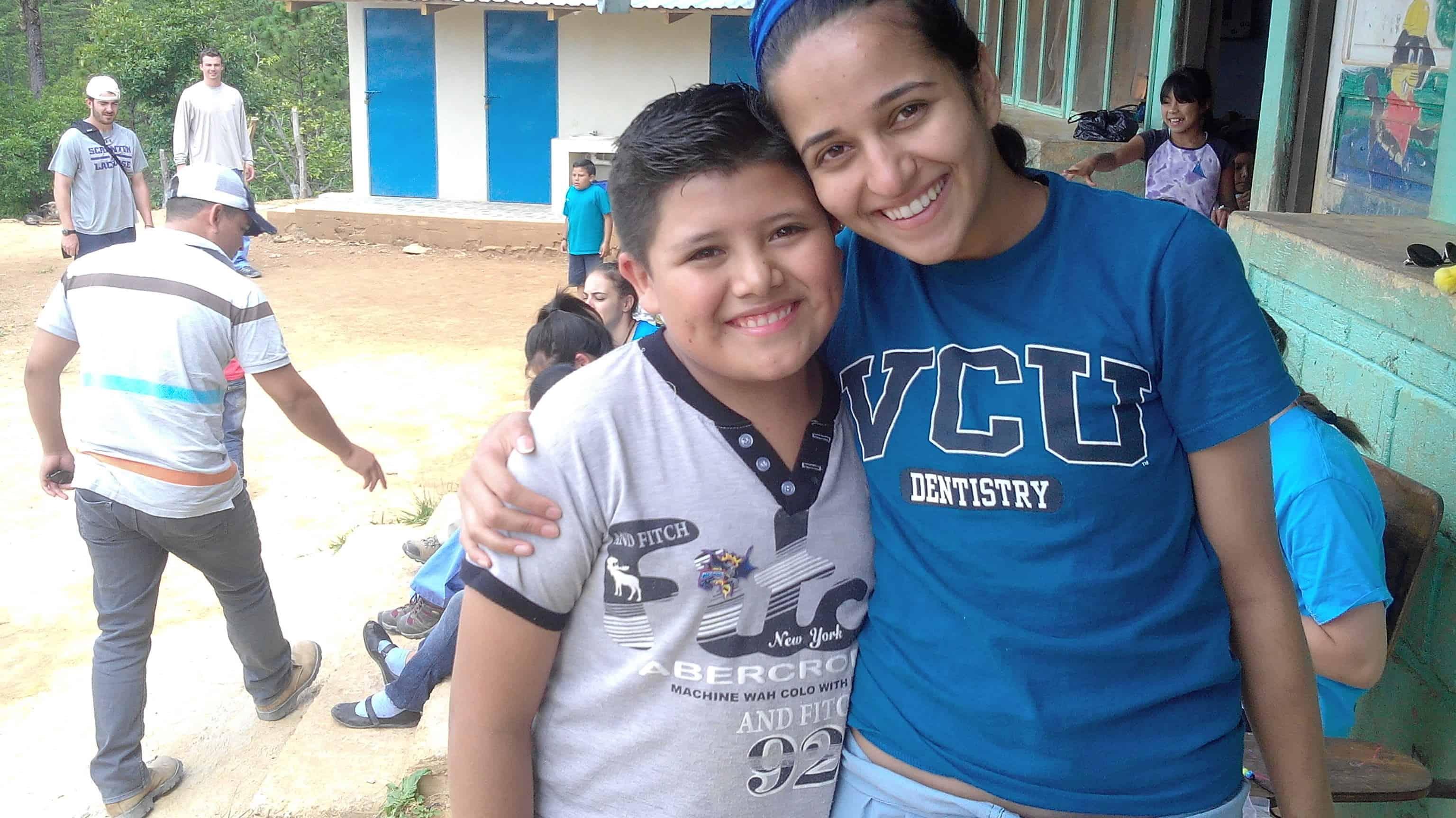 Brigade Member with Happy Kid at Portillo de Norte