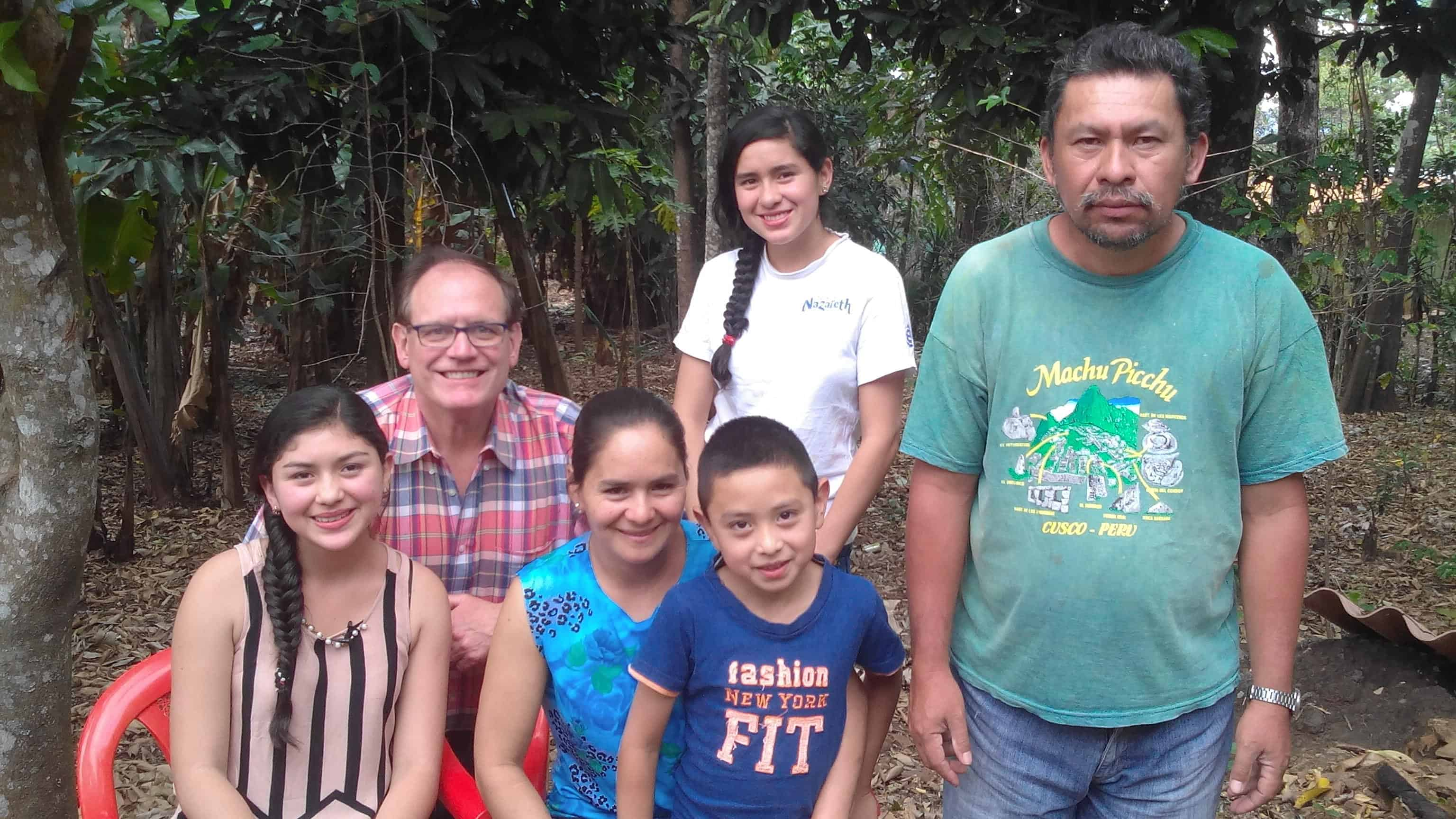 Melisa (far left), a robotics student, with Wayne Waite and family.